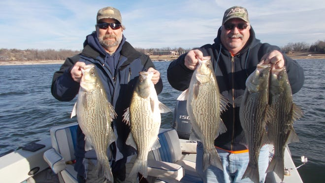 Mitch and Mark from Kansas City show off the spoils of their recent fishing trip on Norfork Lake.