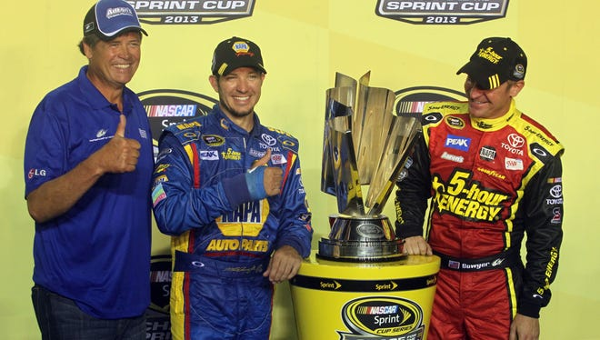 NASCAR Sprint Cup team owner Michael Waltrip with drivers Martin Truex Jr.  and  Clint Bowyer at Richmond International Raceway.