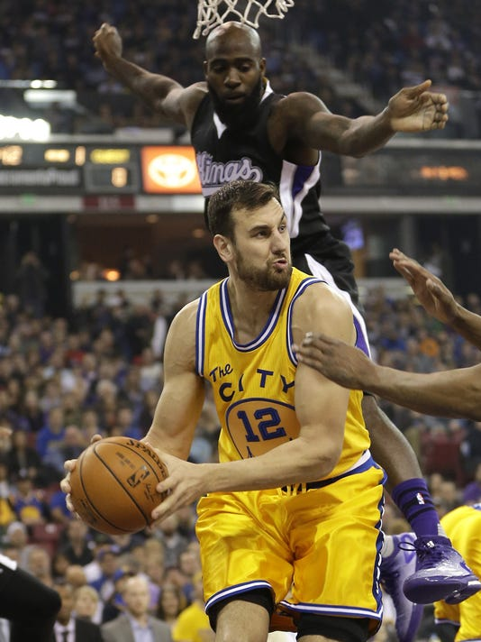 FILE- In this Jan. 9, 2016, file, photo, Golden State Warriors center Andrew Bogut, of Australia, looks to pass as Sacramento Kings forward Quincy Acy, background, defends during the first quarter of an NBA basketball game in Sacramento, Calif. A person with knowledge of the deal says the Dallas Mavericks have agreed to acquire center Bogut from Golden State, which is clearing salary cap room after winning the Kevin Durant sweepstakes. Other details of the trade are still being worked out, the person told The Associated Press on Monday, July 4, on condition of anonymity because the deal hasn't been finalized and can't be official until league business resumes Thursday. (AP Photo/Rich Pedroncelli, File)