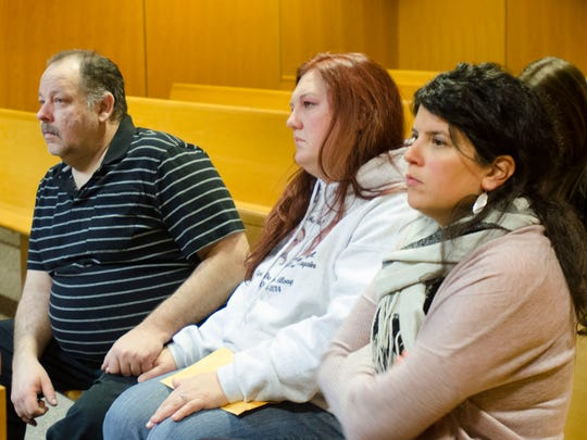 David Lichtenfelt, April Millsap's stepfather, and Jennifer Millsap, April's mother, sit with victim advocate Johanna Delp during a hearing for James Donald VanCallis Nov. 13, 2014, in Macomb County Circuit Judge Denis LeDuc's courtroom. VanCallis is charged with first-degree murder, felony murder and assault with intent to commit sexual penetration in the death of 14-year-old April Millsap.