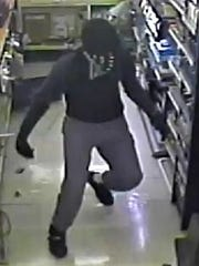 One of two men suspected in a pair of December robberies