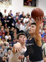 Whitnall's Tyler Herro goes up for a basket around Pewaukee's Grant Basile in a WIAA Division 2 sectional semifinal game March 8 at New Berlin West. Pewaukee won, 60-59, in the highly-anticipated playoff game featuring Division I recruits, Herro and Basile.