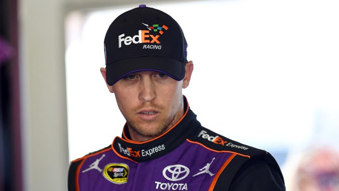 Denny Hamlin's motorcoach sustained superficial damage when it was struck by a rolling SUV at Atlanta Motor Speedway.