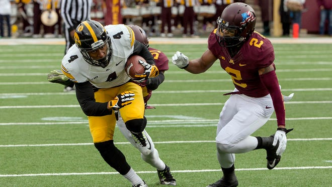 Iowa receiver Tevaun Smith runs for yardage against Minnesota. He started the game strong, but the entire offense collapsed as the 51-14 loss wore on.