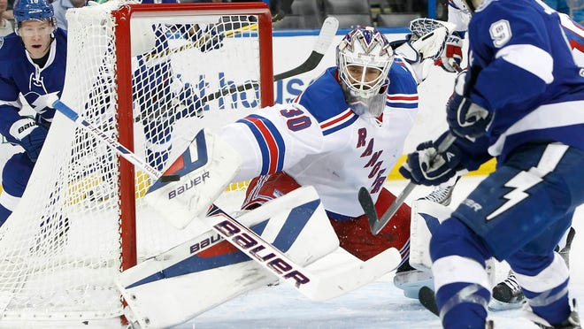 New York Rangers goalie Henrik Lundqvist makes a save during the second period against the Tampa Bay Lightning at Tampa Bay Times Forum.