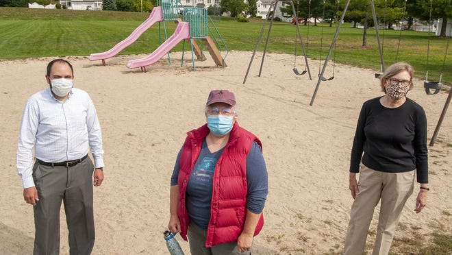 Jason Molina, Missy Hollenback and Melanie Magee, left to right, in the Ternberry Park playground in Shrewsbury on Thursday.