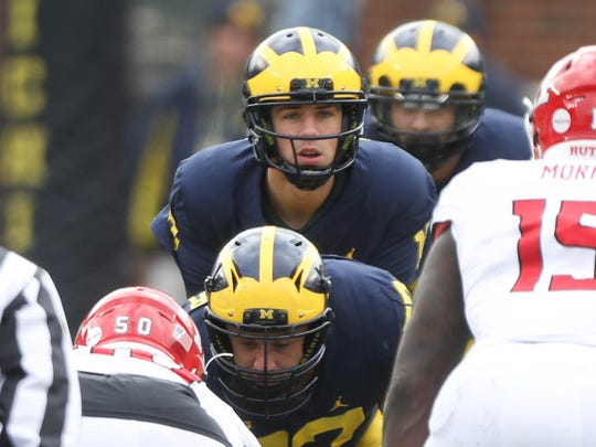 Michigan's Brandon Peters takes the snap from Patrick