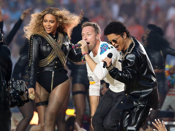 Recording artist Beyonce, Coldplay singer Chris Martin