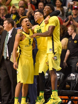 Oregon Ducks guard Tyler Dorsey (5), forward Dillon Brooks (24), and forward Jordan Bell (1) celebrate during the second half in the championship game of the Pac-12 Conference tournament against the Utah Utes at MGM Grand Garden Arena. The Ducks defeated the Utes 88-57.