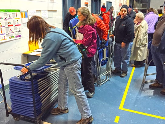 Bolton residents lined up to stack their own chairs