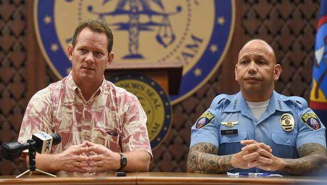 Acting Gov. Ray Tenorio, left, and Guam Police Department Police Chief Joseph I. Cruz hold a press conference to discuss their Tri-Agency Holiday Season Alcohol Suppression Task Force at the Ricardo J. Bordallo Governor's Complex in Adelup on Dec. 1, 2017. The GPD, in collaboration with Guam Department of Parks and Recreation and Guam Department of Agriculture, have teamed up to promote public safety during the holiday season.