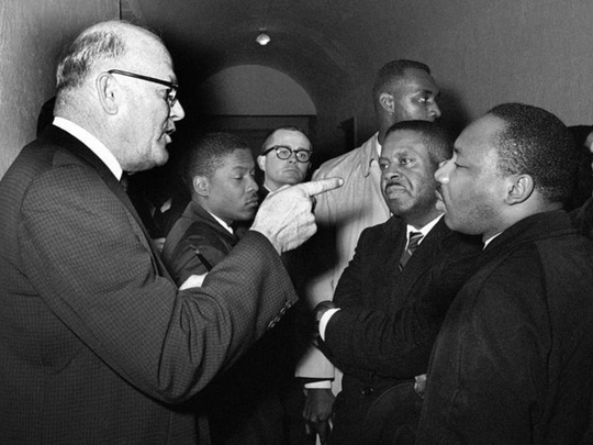 """Registrar Carl Golson shakes a finger at Martin Luther King Jr. during meeting at the courthouse in Hayneyville, Ala. on March 1, 1965. King inquired about voter registration procedures, but Golson told him that if he was not a prospective voter in Lowndes county, """"It's none of your business."""" King visited two nearby counties after leading a voter registration drive in Selma."""