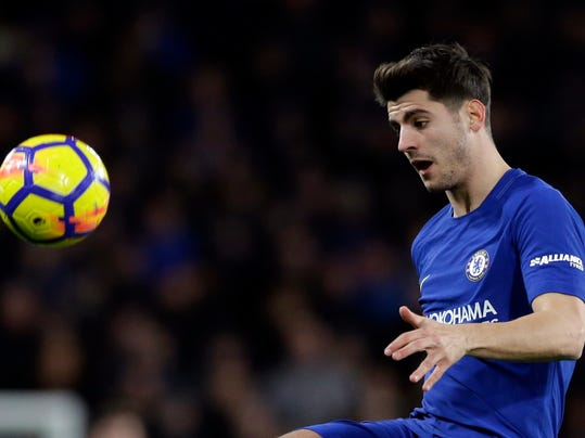 FILE - In this Monday, Feb. 12, 2018 file photo, Chelsea's Alvaro Morata looks to control the ball during the English Premier League soccer match between Chelsea and West Bromwich Albion at Stamford Bridge stadium in London. Alvaro Morata has lost his starting place in Chelsea's team and was dropped from the Spain squad for upcoming friendlies against Germany and Argentina. It has been a tough 2018 for Morata, who has failed to score in 13 matches this calendar year. (AP Photo/Alastair Grant, file)