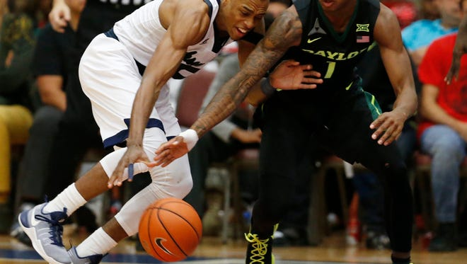Jackson State guard Paris Collins, left, battles Baylor guard Wendell Mitchell, for the ball in the second half of an NCAA college basketball game, Saturday, Dec. 17, 2016, in Fort Hood, Texas.