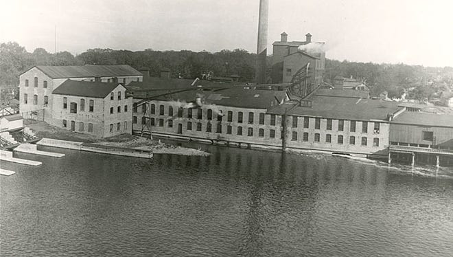 This undated photogrpah is looking across the north branch of the Fox River in Menasha, toward the Menasha Wooden Ware Company. The company was started in 1849 and purchased by Elisha D. Smith in 1852. The company began as a pail factory and later expanded into the production of other wood and container products.