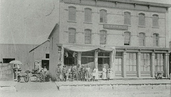 This photograph, circa 1908, shows the Fox River House, 232 Main St., Menasha, was owned by Michael Mielke. It was a boarding house and saloon, with a livery in the back.