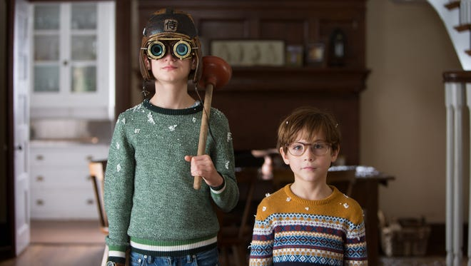 "Henry (Jaeden Lieberher, left) takes care of his younger brother  Peter (Jacob Tremblay) in ""The Book of Henry."""
