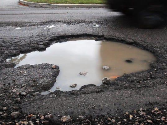 636530952719060534-635602294246369867-07-041114-pothole.JPG
