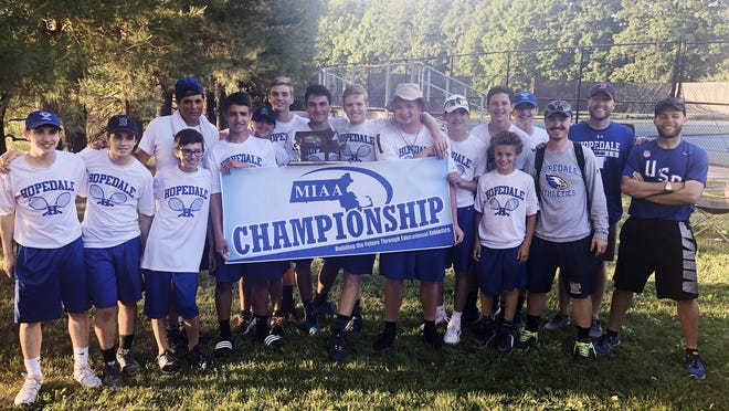 The Hopedale boys tennis team holds its Division 3 Central sectional championship banner and trophy following a 5-0 win over Bromfield in 2019 in Shrewsbury. This season, the Blue Raiders were going to have to replace a lot of players in this photo until the coronavirus pandemic canceled all of spring sports.