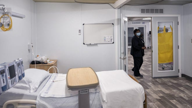 Nurse Manager Betsy Ross inspects a patient room Monday, July 20, 2020, inside the mobile COVID-19 unit at the Northeast Georgia Medical Center in Gainesville, Ga. The unit, constructed from modular buildings by the Georgia Emergency Management and Homeland Security Agency went into operation Tuesday, July 21, 2020, amid high numbers of COVID-19 hospitalizations across the state.