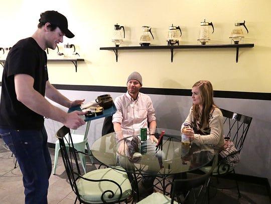 Annie's Fountain City Cafe employee Zach Kollmann delivers