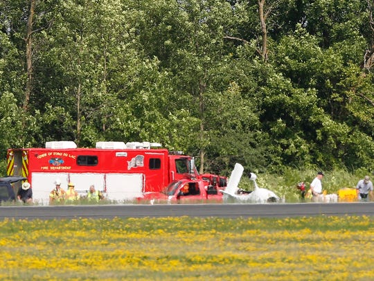 Officials examine the plane crash at the Fond du Lac