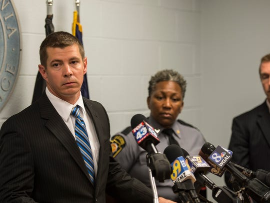Pennsylvania State Police Trooper Norbert Brennan (left) speaks at a press conference where Pennsylvania State Police and the Lebanon County District Attorney's office announced the arrests of four individuals who sold heroin to two victims that each died of an overdose.