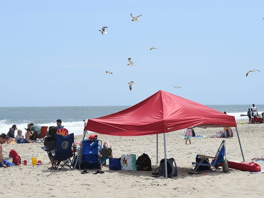 A canopy was set up as cool and windy weather held back the beach crowds, the weekend before Memorial Day in Rehoboth Beach as the Annual Sidewalk Sale was held and visitors walked the Boardwalk.