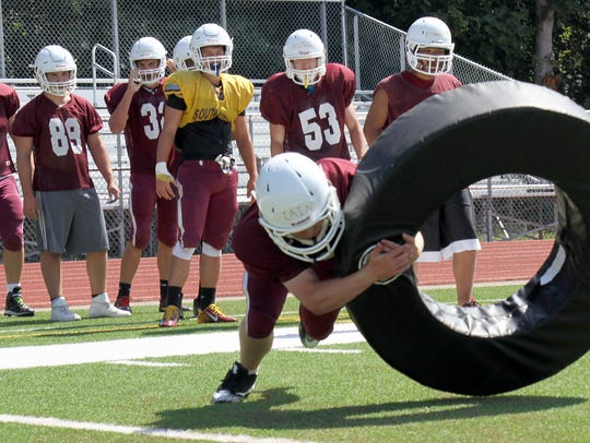 South Kitsap players practice tackling in a drill during