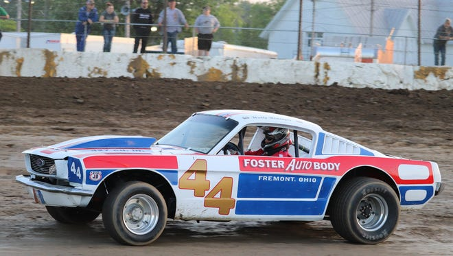 Joe West pilots the restored 1965 Mustang in an exhibition race to honor Ronnie and Donnie Keagan on Hall of Fame Night at Fremont Speedway.