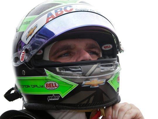 Conor Daly, who drives the No.4 ABC Supply Co. Chevrolet for A.J. Foyt Racing, removes his helmet after practice laps Sunday, May 21, 2017 at the Indianapolis Motor Speedway for the Verizon IndyCar Series.