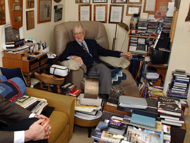 Legnedary UCLA basketball coach John Wooden in the den of his home. Wooden, who died in 2010, is the subject of a new biography by Seth Davis.