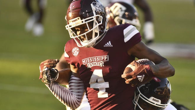 Oct 17, 2020; Starkville, Mississippi, USA; Mississippi State Bulldogs wide receiver Malik Heath (4) scores a touchdown as he is defended by Texas A&M Aggies defensive back Keldrick Carper (14) during the fourth quarter at Davis Wade Stadium at Scott Field. Mandatory Credit: Matt Bush-USA TODAY Sports