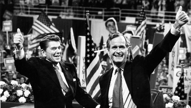 Ronald Reagan and his vice president, George H.W. Bush, appear at the Republican National Convention in Detroit's Joe Louis Arena on July 14, 1980.