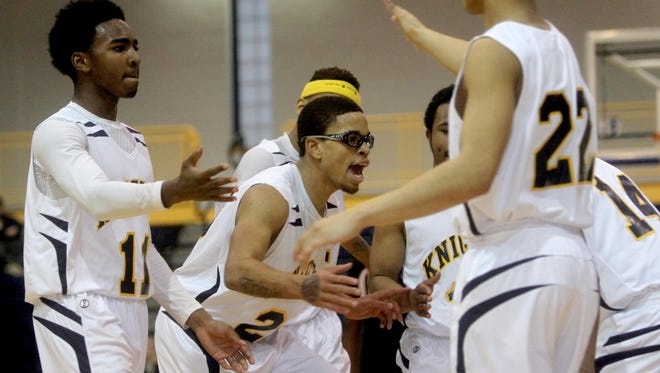 Taiquam Johnson, center and Clark Academy teammates celebrate during the final minutes of the Class D regional final basketball game against Bridghampton at Pace University in Pleasantville March 4, 2016. Clark Academy defeated Bridghampton 67-56 to advance to the Class D state semifinal.