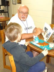 Tom Brzezinski reads to a student as part of the United Way Reading Buddies program at Mosinee Elementary School.