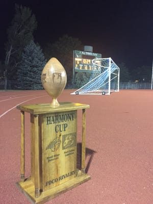 The Harmony Trophy awaits Fort Collins High School, as the Lambkins downed crosstown rival Fossil Ridge, 17-6.