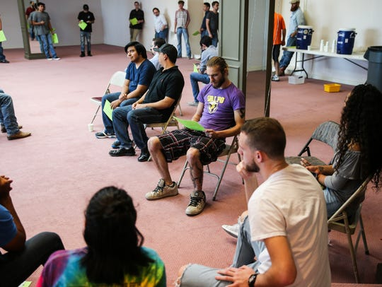 People wait for their chance to audition for characters
