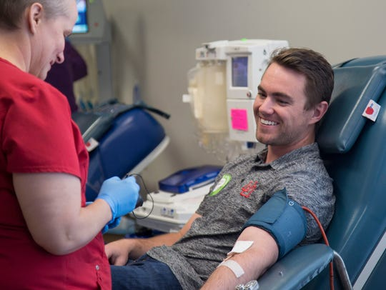Zachary Sterbens gives a Power Red donation at the