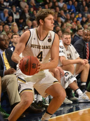 Notre Dame Fighting Irish guard Matt Ryan drives the lane around Chicago Cougars guard Anthony Eaves during action at Purcell Pavilion at the Joyce Center.