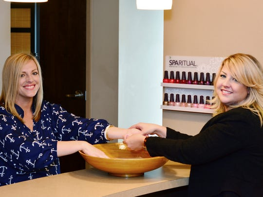 Jen Peck, manager of Fusion Salon Spa, gives Natasha a stress-relieving manicure.