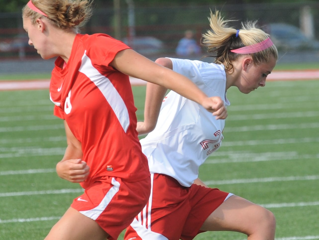 Richmond's Samantha Wilson makes a move around Jay County's Sophie Bader on Tuesday at Lyboult Field.