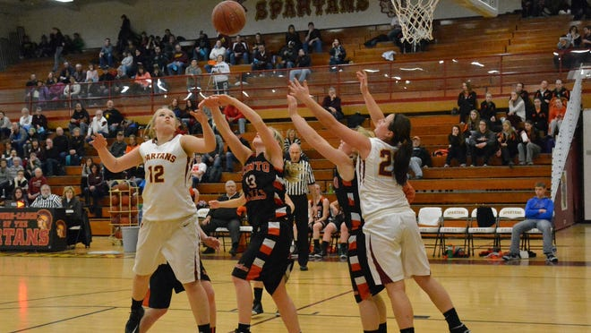 L-C's Alexis Dorner and Sarah Kinnard scramble to obtain possession from Oconto Falls' Bailey Wolf.