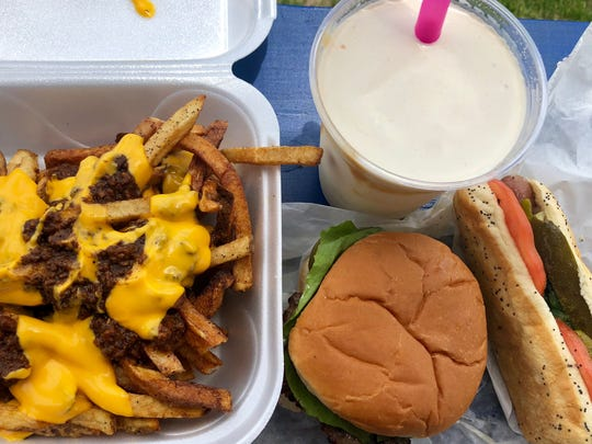Chili cheese fries, a cheeseburger, Chicago dog and