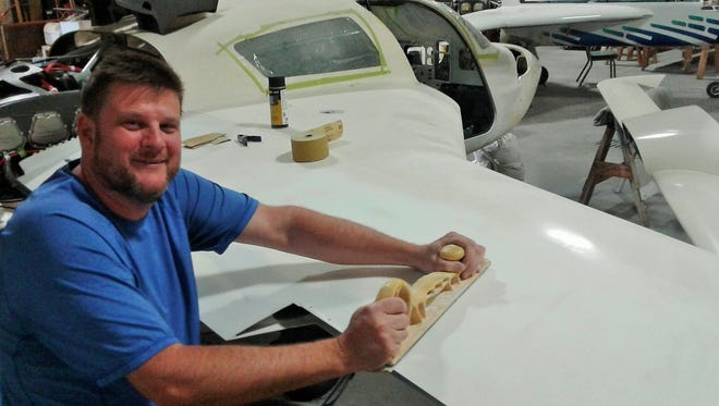 Hand-sanding a wing is just one of hundreds of final-phase steps for the meticulous John Tvedte of Iowa City as he works to complete his Velocity XL experimental aircraft.