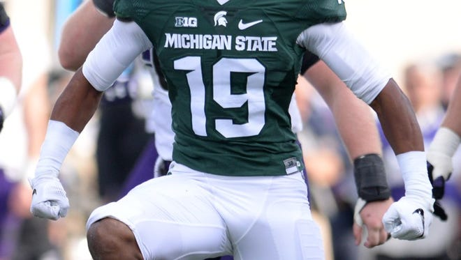 Redshirt freshman cornerback Josh Butler (19) celebrates after sacking Northwestern quarterback Clayton Thorson during the game against Northwestern on Saturday, Oct. 15, 2016 at Spartan Stadium in East Lansing.