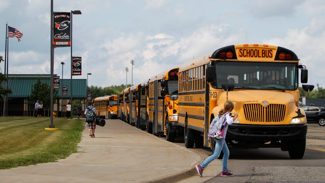 A line of buses picks up students from Charlotte Upper Elementary and Middle Schools Tuesday afternoon, Aug. 22, 2017, outside of Charlotte Middle School, following the second day of school.