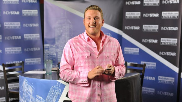 Colts punter Pat McAfee talks during the opening monologue of IndyStar's Pat McAfee Show at Kilroy's in Broad Ripple on Oct. 15, 2013.