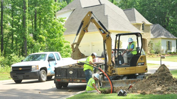 Constuction crews install duct to house C Spire's Fiber To The Home high-speed Internet Service Thursday along Green Glades in the Bridgewater subdivision in Ridgeland. Ridgeland joins Mississippi's other first gigabit cities, Quitman, Horn Lake, and Starkville.