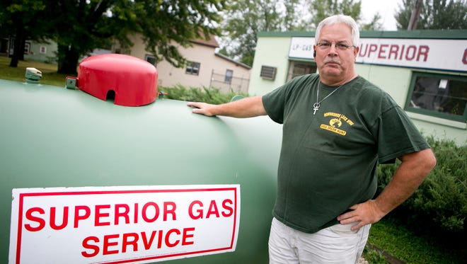 Manager of Superior Gas Service Inc. Ron Johnson stands in front of the storefront in Marshfield.